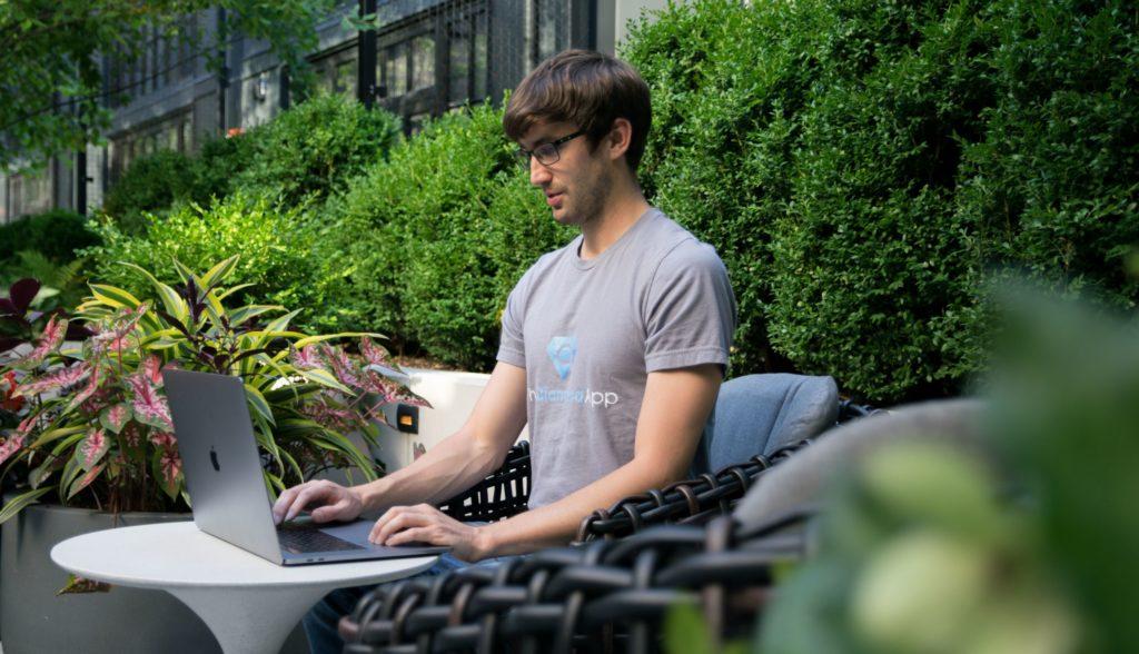 Tony Florida working on his MacBook Pro laptop